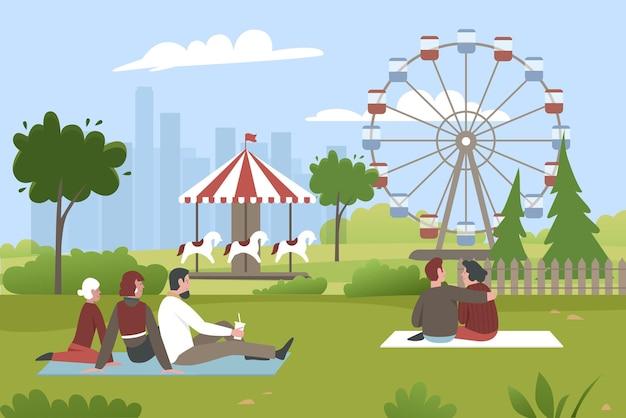 Personaggi che si siedono sull'erba verde nel parco estivo con fiera di carnevale