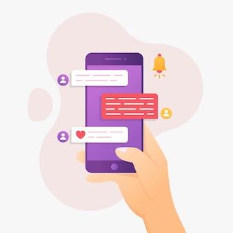 Concetto di design in chat con il cellulare della tenuta della mano
