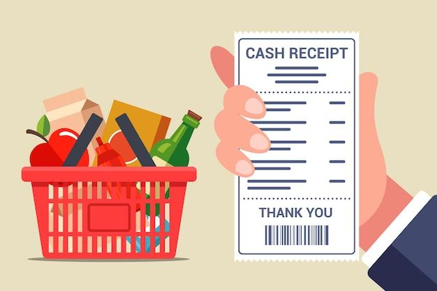 Controllo di un assegno da un negozio di alimentari. cestino pieno con cibo fresco. illustrazione piatta.