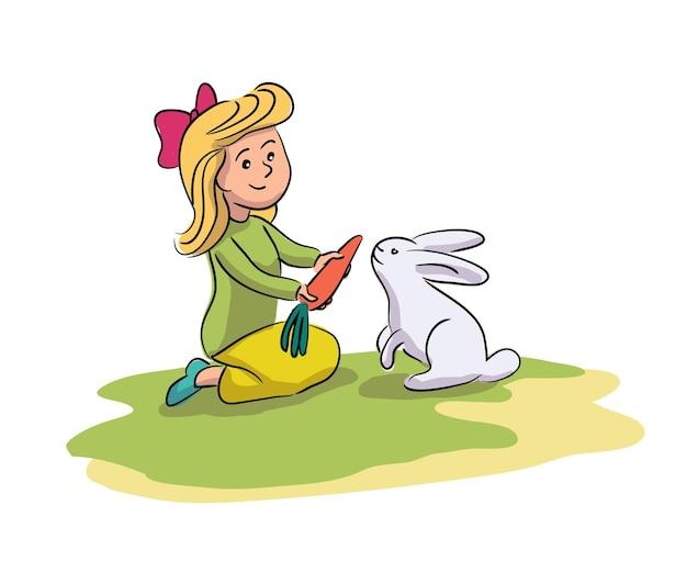 Bambina allegra alimentazione dando carota carino coniglio grigio sul bambino felice cortile dell'azienda agricola e contatto con animali domestici