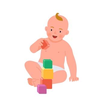 Bambino sorridente allegro che gioca con i cubi colorati. bambino che gioca giocattolo in via di sviluppo. giocattoli per bambini piccoli. sviluppo iniziale