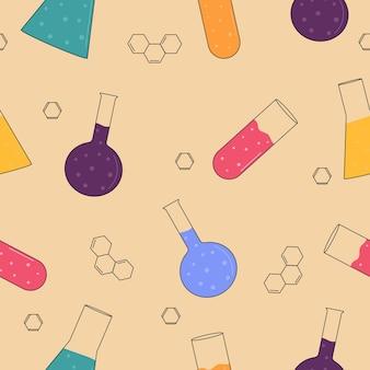 Reticolo senza giunte di chimica. boccette chimiche multicolori su fondo beige
