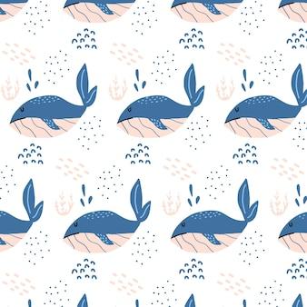 Modello senza cuciture disegnato a mano infantile con balene blu modello con balene e alghe
