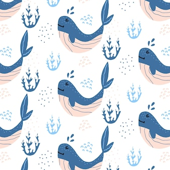 Modello senza cuciture disegnato a mano infantile con balene blu