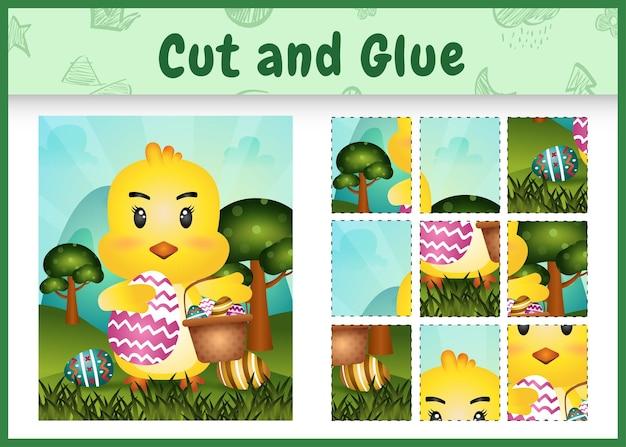 Gioco da tavolo per bambini taglia e incolla la pasqua a tema con un simpatico pulcino che tiene l'uovo del secchio e l'uovo di pasqua