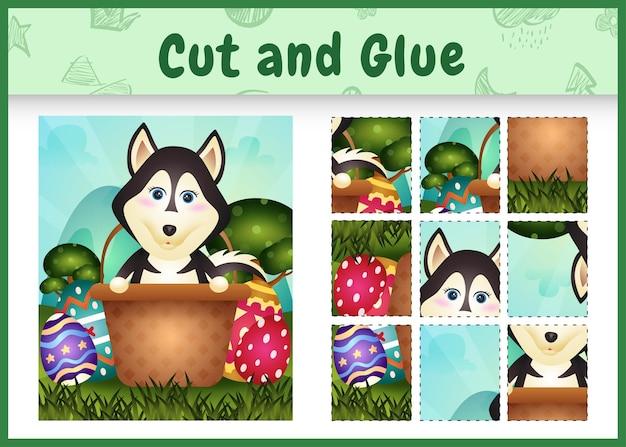Gioco da tavolo per bambini taglia e incolla a tema pasqua con un simpatico cane husky nell'uovo del secchio