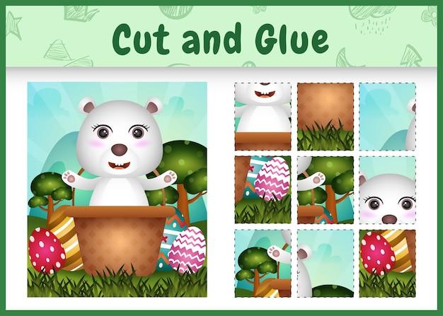 Gioco da tavolo per bambini taglia e incolla a tema pasqua con un simpatico orso polare nel secchio dell'uovo