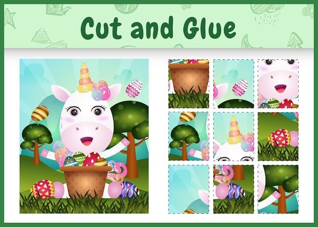 Gioco da tavolo per bambini taglia e incolla la pasqua a tema con un simpatico unicorno nel secchio dell'uovo
