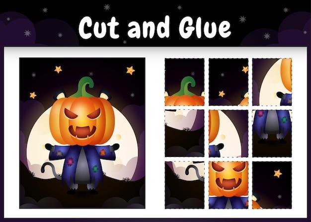 Gioco da tavolo per bambini taglia e incolla con un simpatico gatto nero usando il costume di halloween