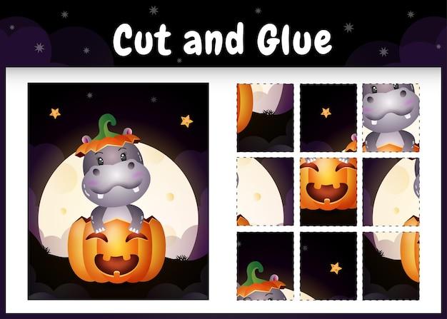 Gioco da tavolo per bambini taglia e incolla con un simpatico ippopotamo nella zucca di halloween