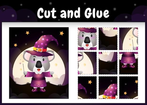 Gioco da tavolo per bambini taglia e incolla con un simpatico koala usando il costume di halloween