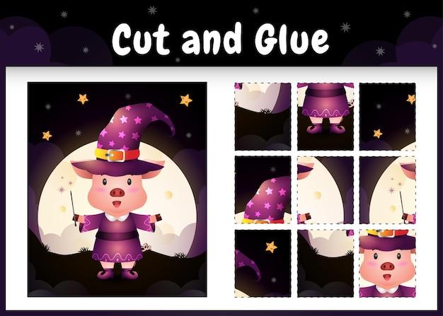 Gioco da tavolo per bambini taglia e incolla con un maiale carino usando il costume di halloween
