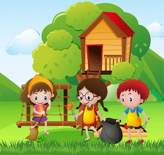 Bambini che puliscono il parco