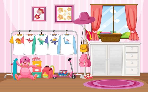 Vestiti per bambini su uno stendibiancheria con molti giocattoli nella scena della stanza