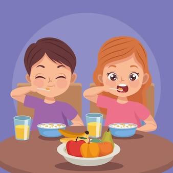 Un ragazzino felice di fare colazione al mattino. isolato | Vettore Premium