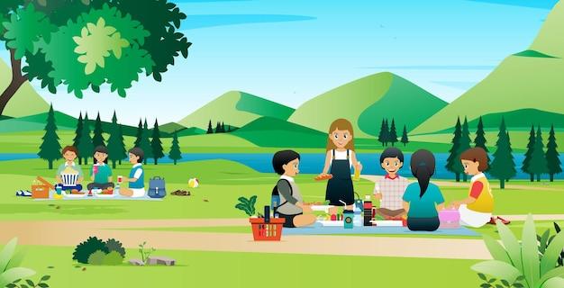 I bambini hanno fatto un picnic in un parco con un fiume che scorre.