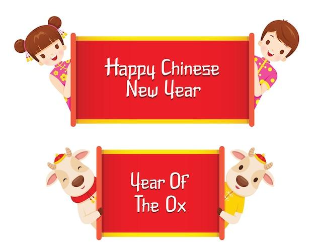 Bambini e bue con banner di felice anno nuovo cinese e anno del bue