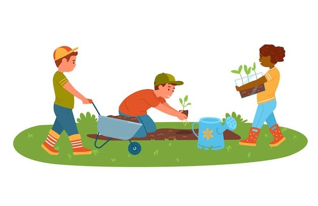 Bambini che piantano piantine nel giardino della scuola