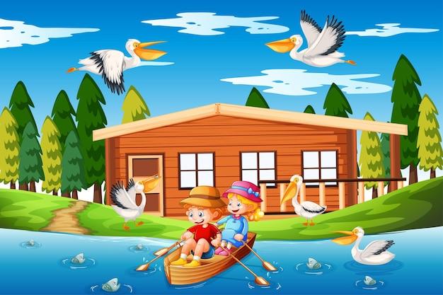 I bambini remano sulla barca nella scena della foresta del torrente