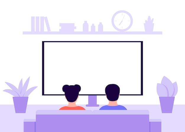 Bambini seduti sul divano di casa e guardare la tv vista posteriore bambini ragazzo e ragazza siedono in soggiorno