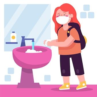 I bambini si lavano le mani a scuola