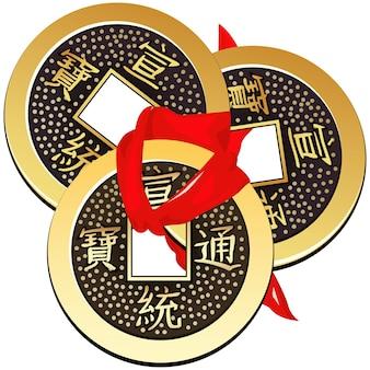 Moneta cinese legata con nastro rosso. un quadrato all'interno di un cerchio di antiche monete cinesi della dinastia tang, le cui copie sono usate nel feng shui.