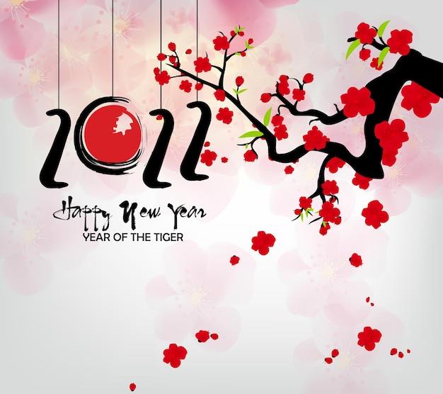 Capodanno cinese 2022 anno della tigre fiore rosso e oro ed elementi asiatici carta tagliata con artigianato
