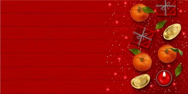 Sfondo di capodanno cinese con mandarini cinesi lingotti d'oro e regali