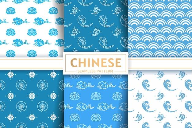 Modelli cinesi senza soluzione di continuità insieme di vettore floreale cielo marino texture fiori di loto