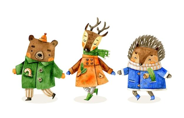 Collezione di animali natalizi con riccio orso cervo in abiti invernali