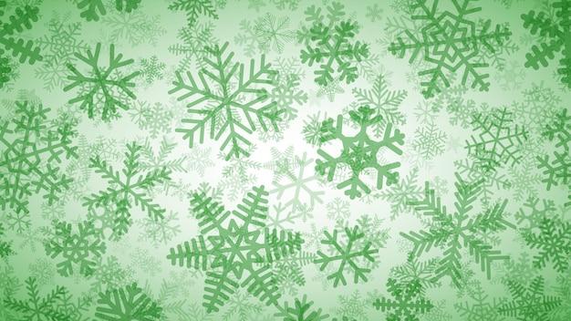 Sfondo natalizio di molti strati di fiocchi di neve di diverse forme, dimensioni e trasparenza. verde su bianco