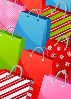 Sfondo di natale con sacchetti regalo colorati - poster, banner o modello di biglietto di auguri vettoriale