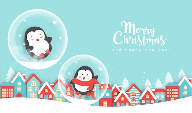 Sfondo di natale con simpatici pinguini nel villaggio di neve e spazio o testo.