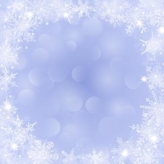 Sfondo natalizio con cornice di fiocchi di neve a forma di cerchio in colori viola e con effetto bokeh
