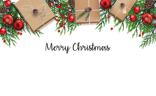 Sfondo di natale con scatola regalo e ornamento di palle rosse