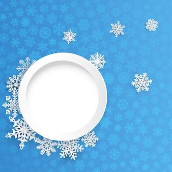 Sfondo di natale con cornice rotonda e fiocchi di neve di carta su sfondo blu di piccoli fiocchi di neve