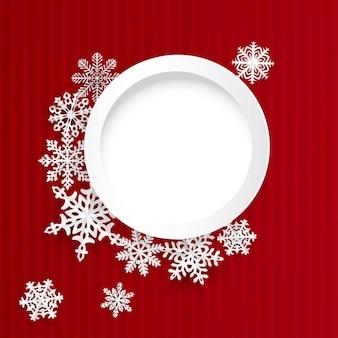 Sfondo di natale con cornice rotonda e fiocchi di neve di carta su sfondo a strisce rosse