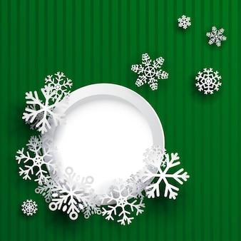 Sfondo di natale con cornice rotonda e fiocchi di neve su sfondo a strisce verdi