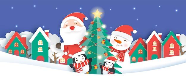 Sfondo di natale con un babbo natale e amici nel taglio della carta del villaggio di neve e stile artigianale.
