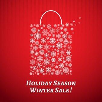 Sfondo di natale con una borsa della spesa da fiocchi di neve bianchi su sfondo a strisce rosse