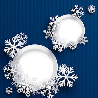 Sfondo di natale con due cornici rotonde e fiocchi di neve su sfondo a strisce blu
