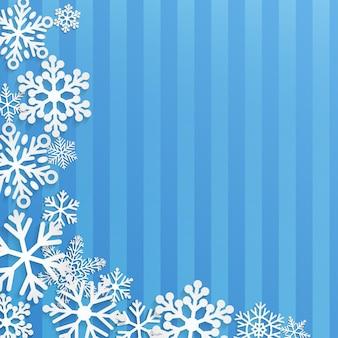 Sfondo di natale con fiocchi di neve bianchi su sfondo a strisce blu