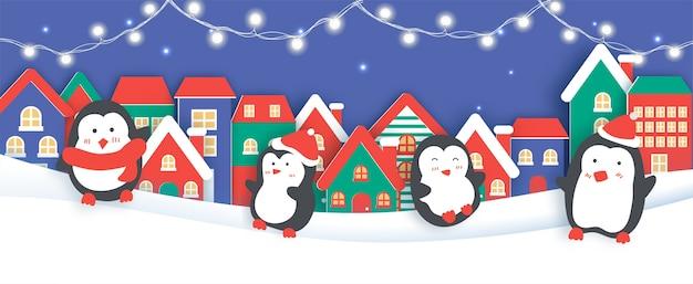 Banner di natale, sfondo con un pinguino nel taglio della carta del villaggio di neve e stile artigianale.