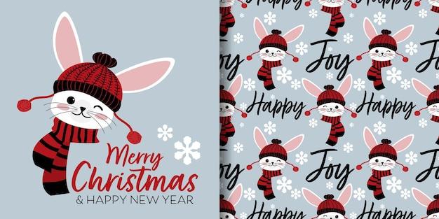 Lo striscione natalizio e il modello senza cuciture di coniglio indossano una sciarpa rossa su sfondo grigio con fiocchi di neve