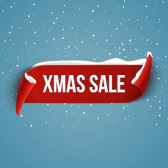 Sfondo di grande vendita di natale con nastro rosso realistico con la neve.