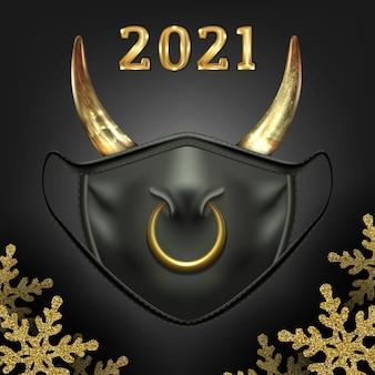Simbolo di maschera facciale nera di natale del nuovo anno del toro con anello al naso e corna di mucca su uno sfondo scuro con fiocchi di neve lucenti