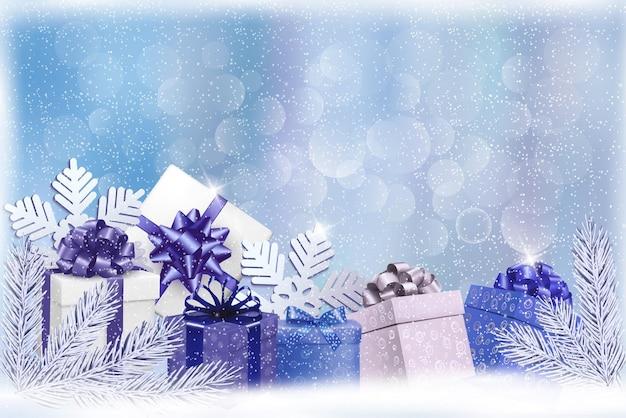 Sfondo natale blu con scatole regalo e fiocchi di neve.