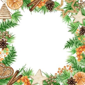 Cornice natalizia boho con rami di pino, bastoncino di cannella, anice stellato, arancia. bordi dell'acquerello dell'annata