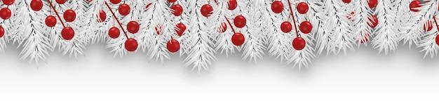 Decorazioni natalizie di confine con rami bianchi di abete e bacche di agrifoglio.