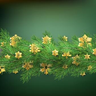 Bordo di natale fatto di rami di pino dall'aspetto realistico con fiocchi di neve lamina d'oro su verde.